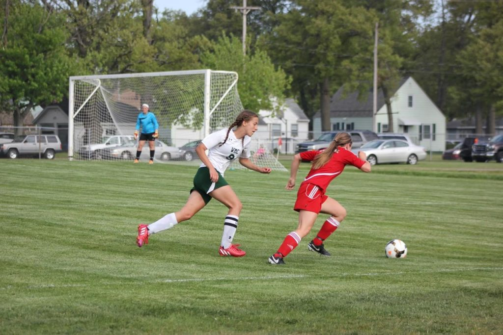 Spring Lake's Emily Batts gets past WMC's  -Brea Frein. Photo/Jeff Erickson