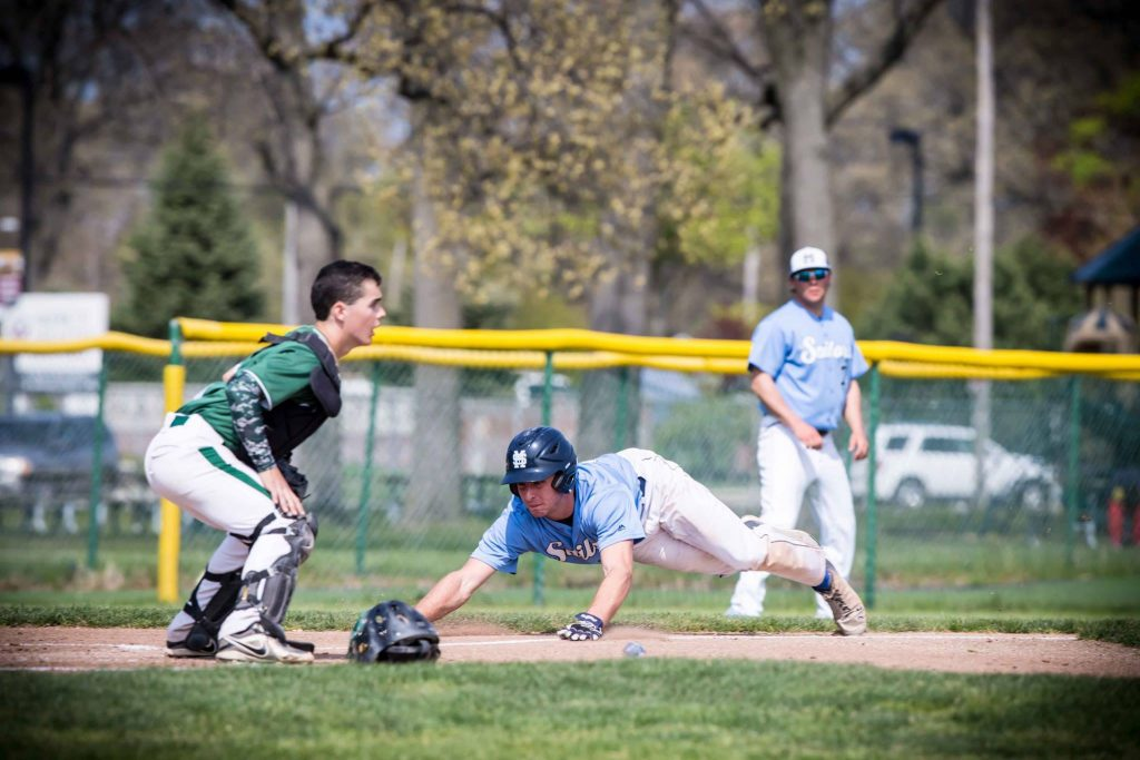 Broersma slides head first into home plate. Photo/Tim Reilly