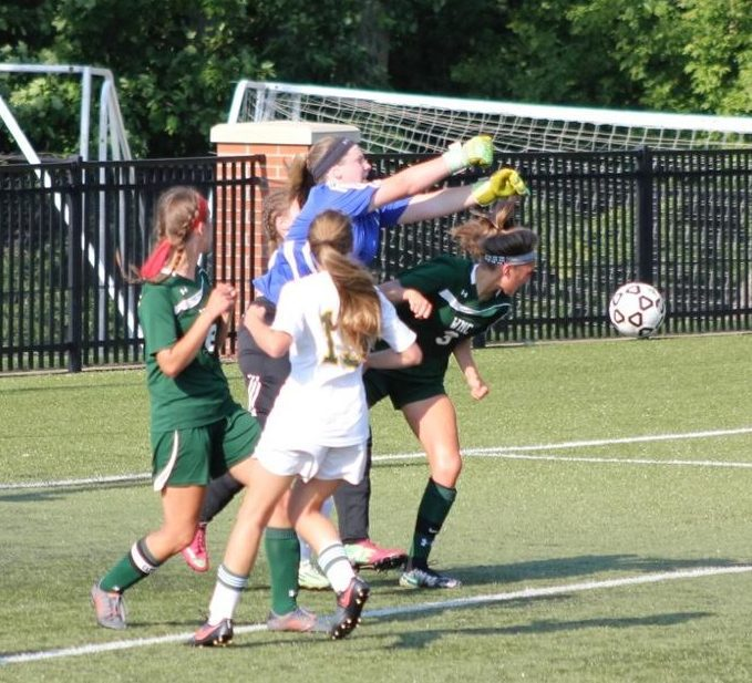 WMC keeper Ashlyn Lane punches out a corner kick. Photo/Jeff Erickson