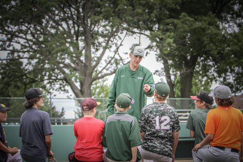 Coach Logan Fleener talks to the campers. Photo/Joe Lane