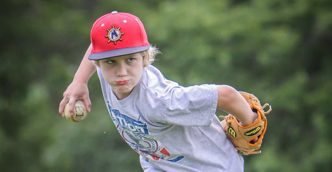 Muskegon Clippers coaches, players tutoring area youngsters at baseball camp