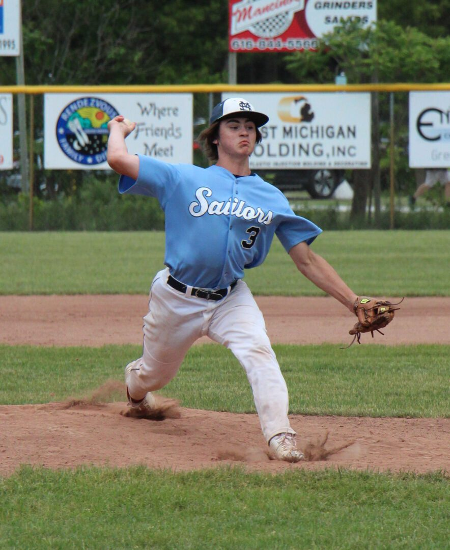 Austin Flowers delivers the pitch to home plate for Mona Shores. Photo/Jason Goorman