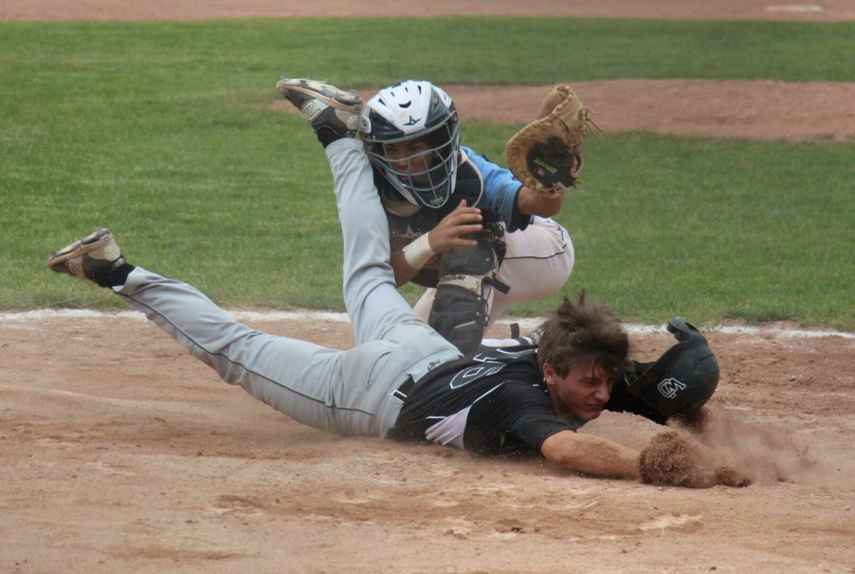 Elijah Wilson tags out West Ottawa's Adam Dykens at home plate. Photo/Jason Goorman
