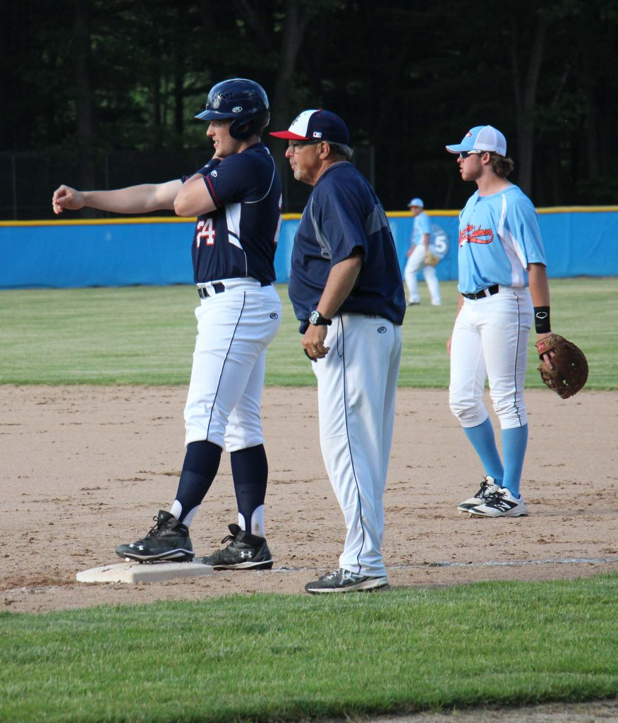 Andrew Null listens to first base coach Brian Wright. Photo/Steve Gunn