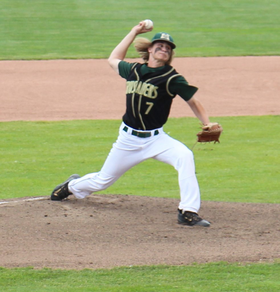Devin Comes delivers the pitch for the Crusaders. Photo/Dave Hart