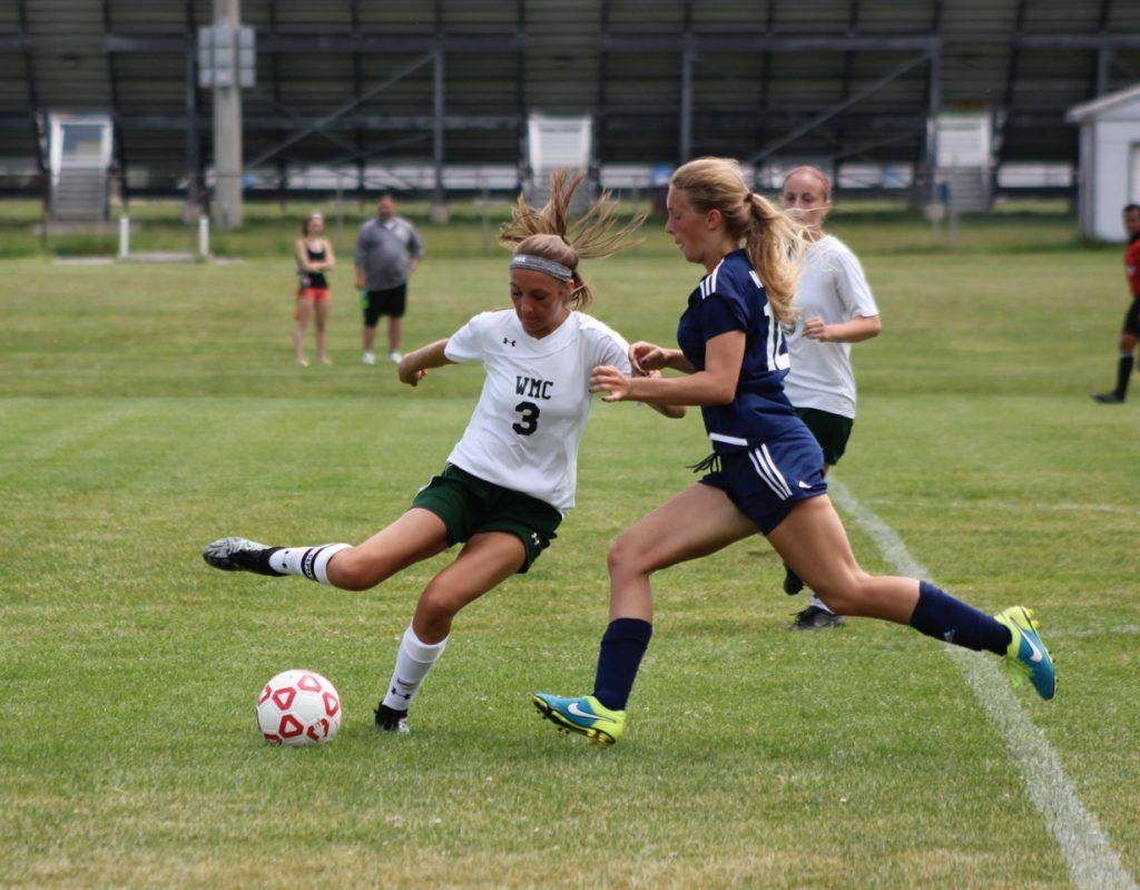WMC's Mikaela Erickson cuts back past Marion Eaker. Photo/Jeff Erickson
