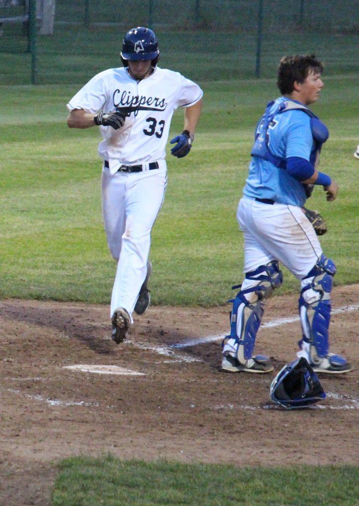 Muskegon designated hitter Jared Burton crosses home plate. Photo/Steve Gunn