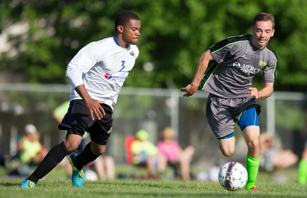 Emmitt Mikkelson fights for the ball in FC Adrenaline's zone. Photo/Kevin Sielaff