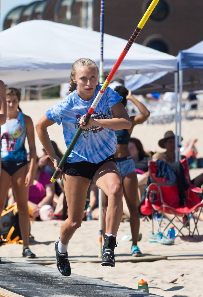 Bella Leroux participates in the high school girl's elite pole vault event on Grand Haven City Beach. Photo/Kevin Sielaff