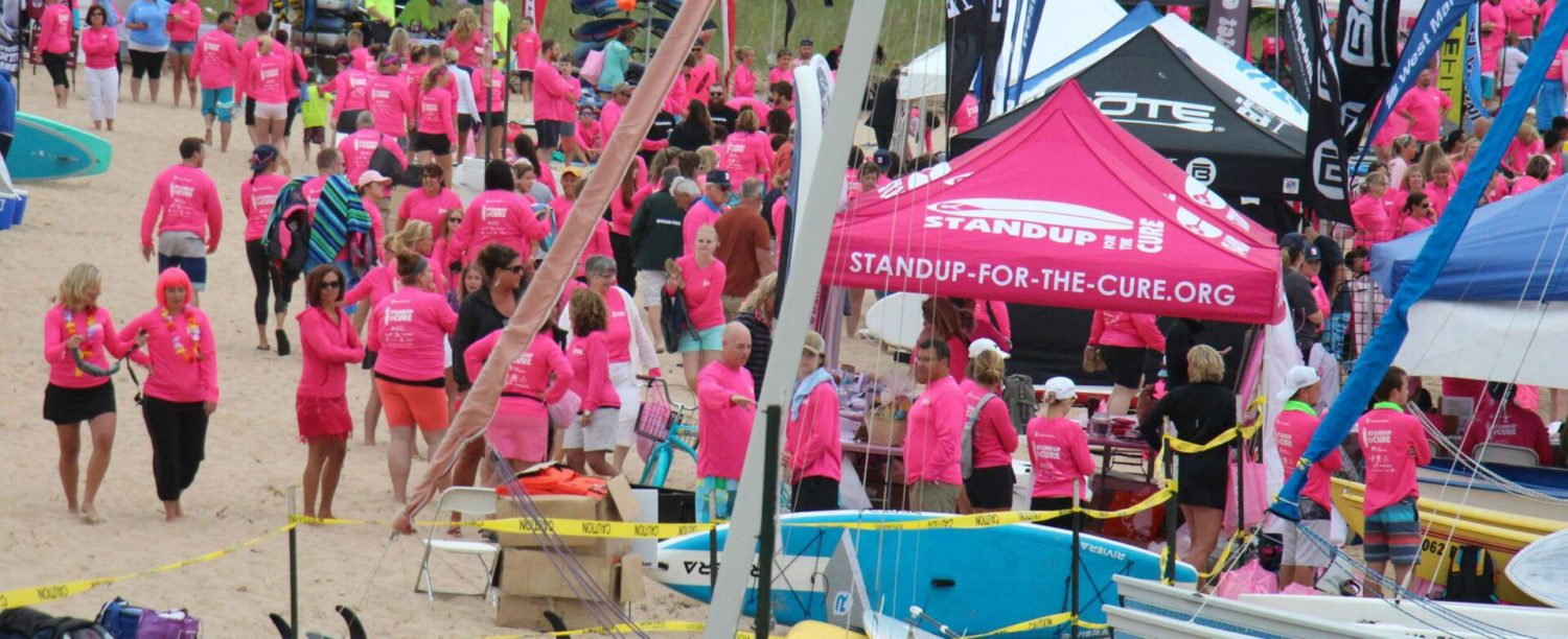 Hundreds turn out for the 'Standup for the Cure' paddle board event at Harbor Towne