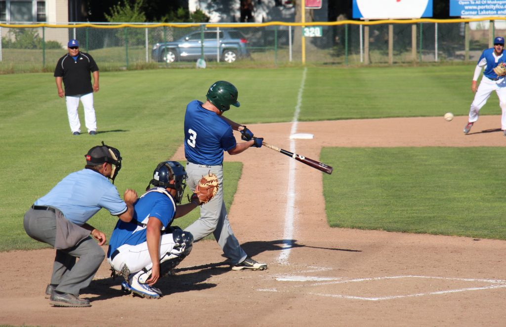 Tim Lertel connects while hitting for the Loggers. Photo/Jason Goorman