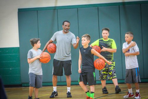 Muskegon resident and area educator Rodney Anderson Sr. instructs campers. Photo/Joe Lane