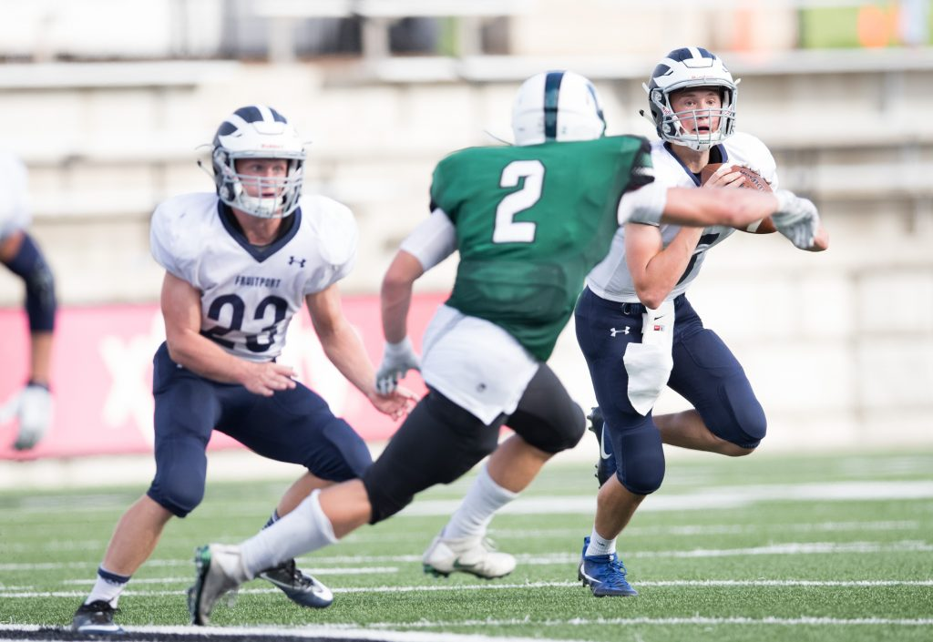 QB Connor Routt (5) moves back in the pocket and looks to fire a pass down field. Photo/Kevin Sielaff