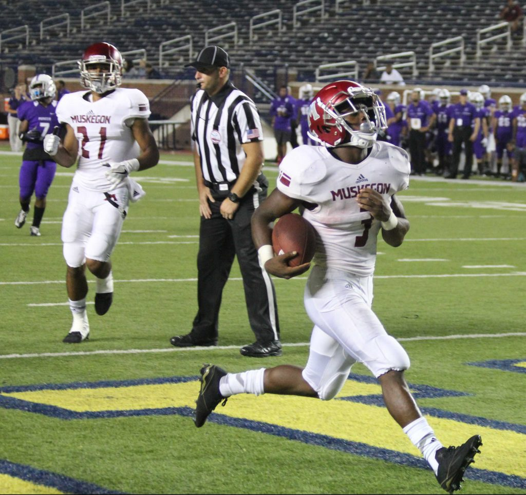 Kalil Pimpleton breaks into the end zone for Muskegon. Photo/Brian Tanis