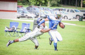 Maurice Sherrill shakes off s Flint tackle. Photo/Joe Lane