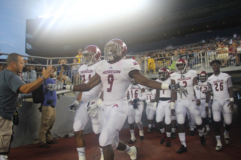 Andrew Ward leads the Big Reds out of the tunnel at the Big House. Photo/Brian Tanis