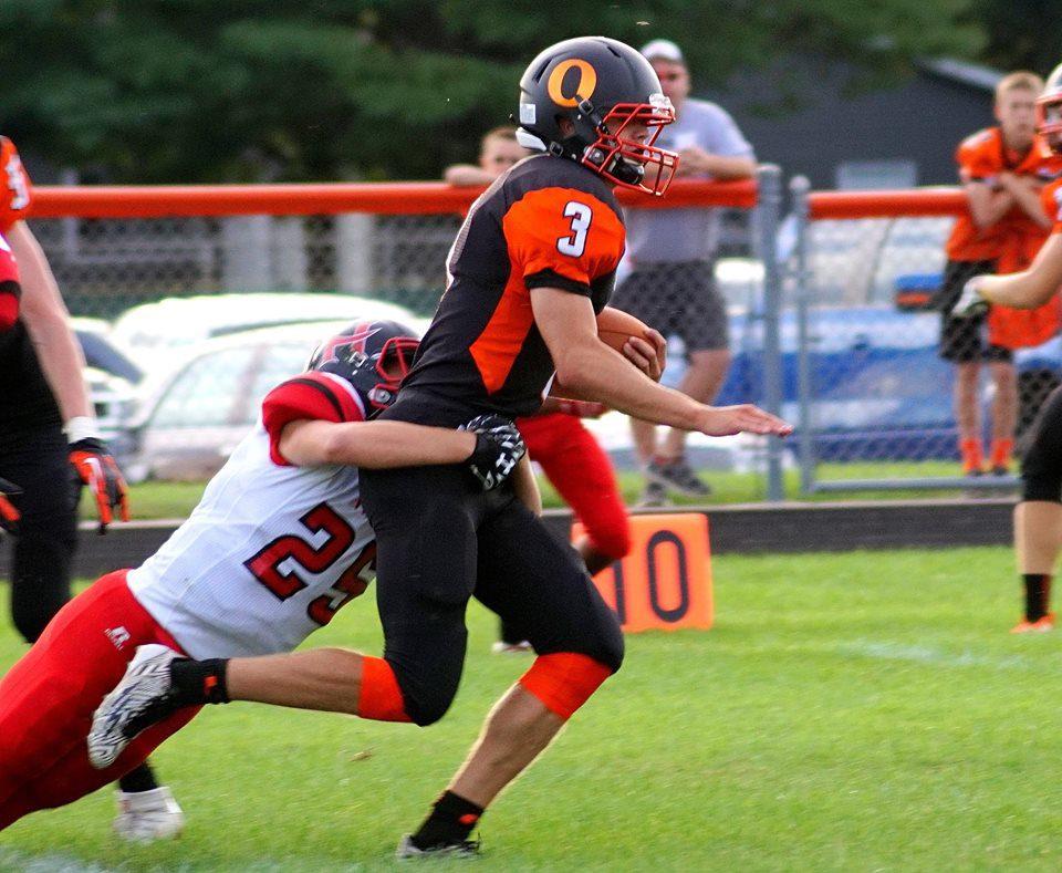 Ludington's Jared Collins tacked by Hart's Aaron VanSickle. Photo/Leo Valdez