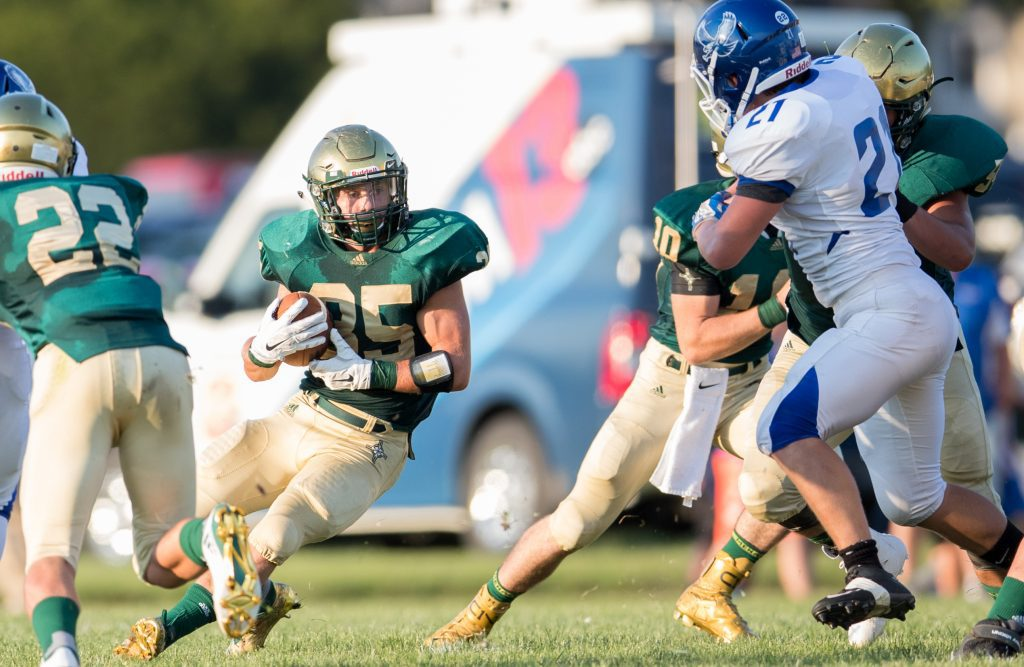 Logan Helton (35) looks for a hole in a game earlier this season. Photo/Kevin Sielaff