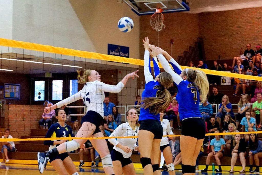 No. 15 Emily Pieczynski slips a shot over the net for MCC. Photo/Leo Valdez