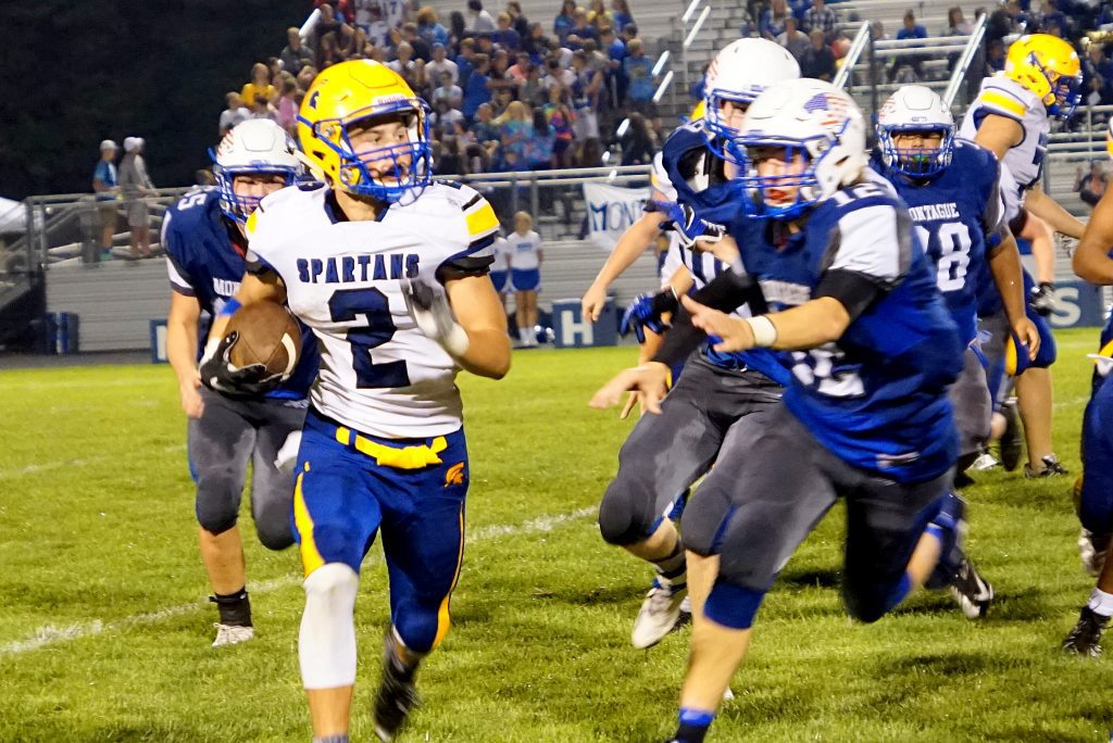 Travis Tyndall rushes the ball up the sideline for Mason County Central. Photo/Leo Valdez