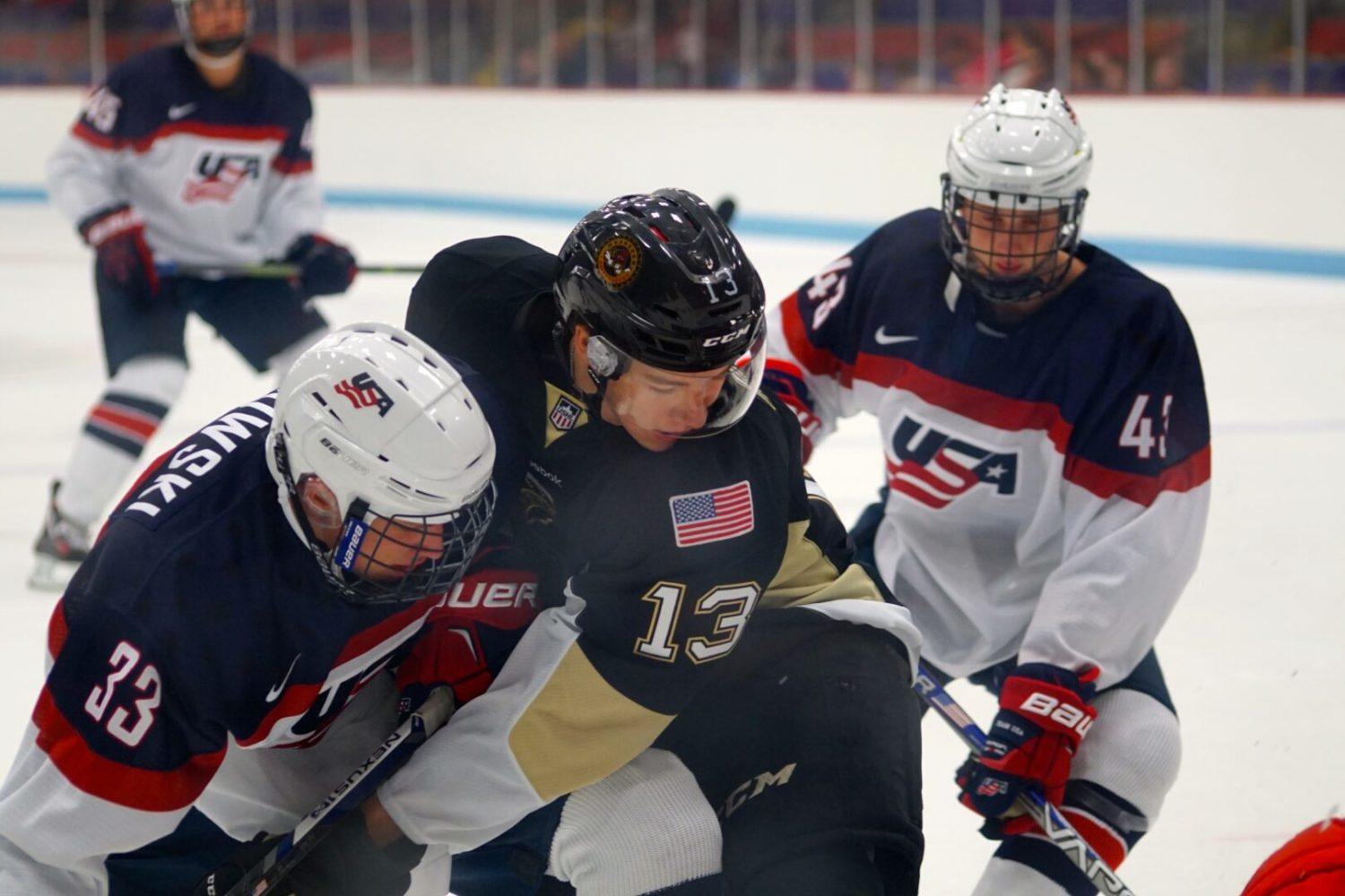 No. 13 Collin Adams battles for the puck against Team USA.