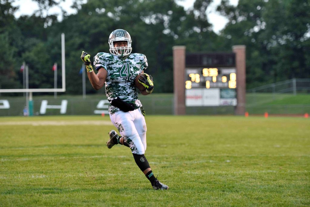 Theo Stevenson (4) strolls into the endzone for Reeths Puffer's second touchdown of the first quarter. Photo/Eric Sturr