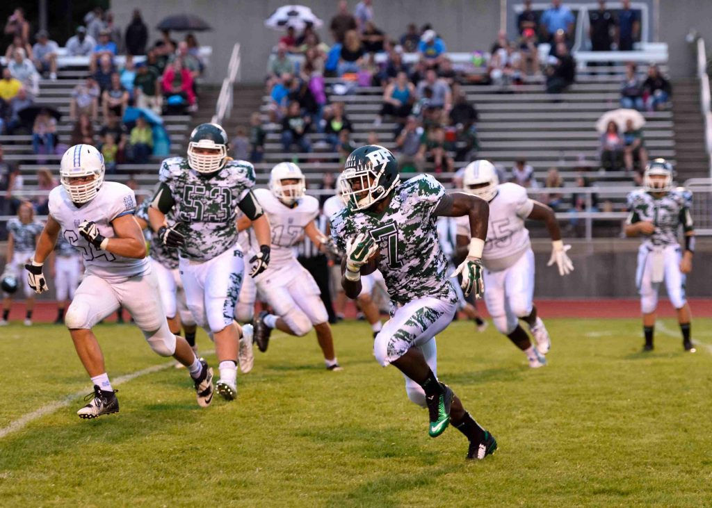 Nate McCrary (7) takes a flat pass for a large gain. Photo/Eric Sturr