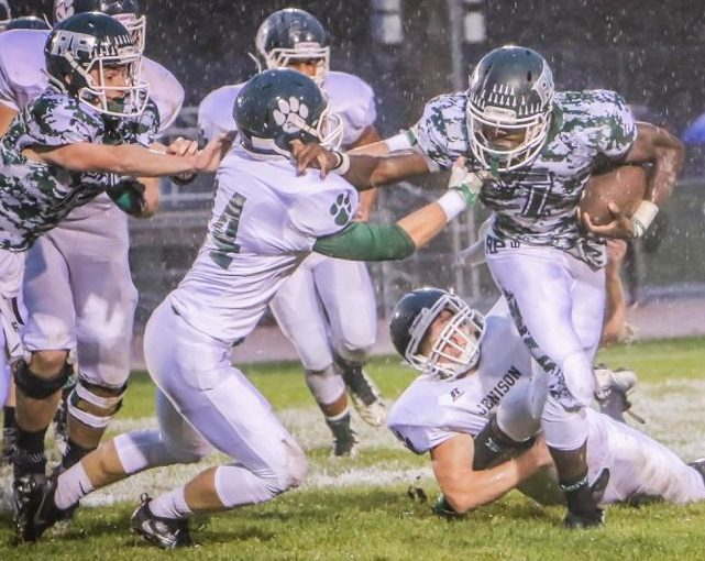 RPs No. 7 Nate McCrary fights off Jenison tacklers for extra yards. Photo/Joe Lane
