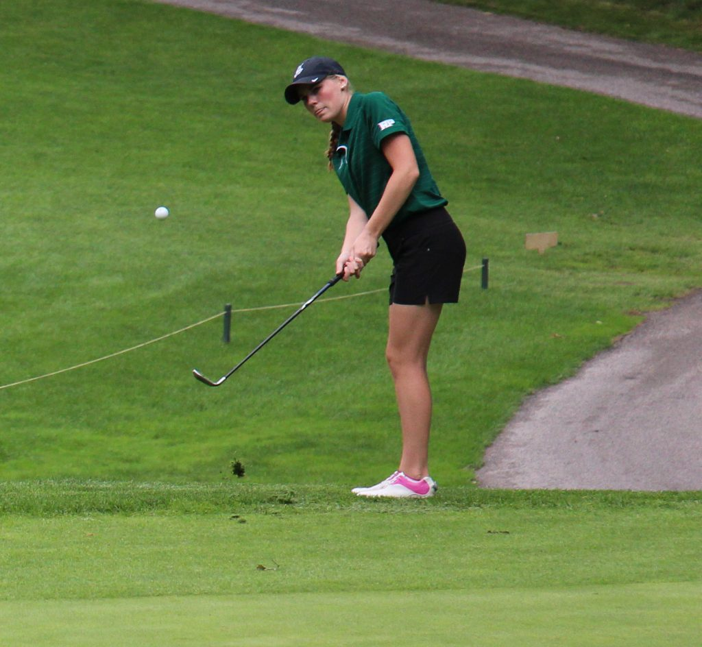 Avery Howard takes a chip shot just off the 10th green during Wednesday's GMAA golf tourney. Photo/Jason Goorman