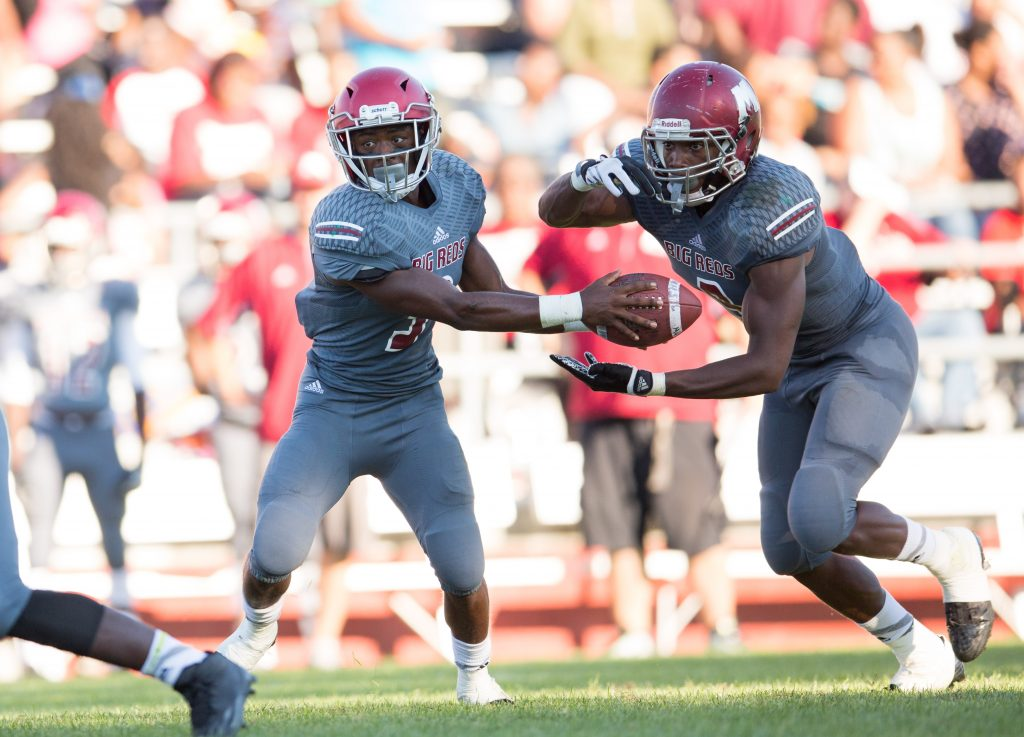Kalil Pimpleton (3) hands the ball off to Andrew Ward (9). Photo/Kevin Sielaff