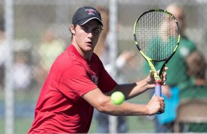 Andy Esh of Whitehall returns competes in the No. 1 singles title match. Photo/Kevin Sielaff