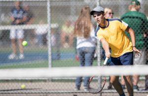 Bobby Tarrant of North Muskegon returns the ball. Photo/Kevin Sielaff