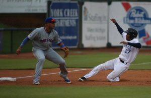 Jose Azocar slides safely into third base for the Whitecaps. Photo/Tom Reynolds