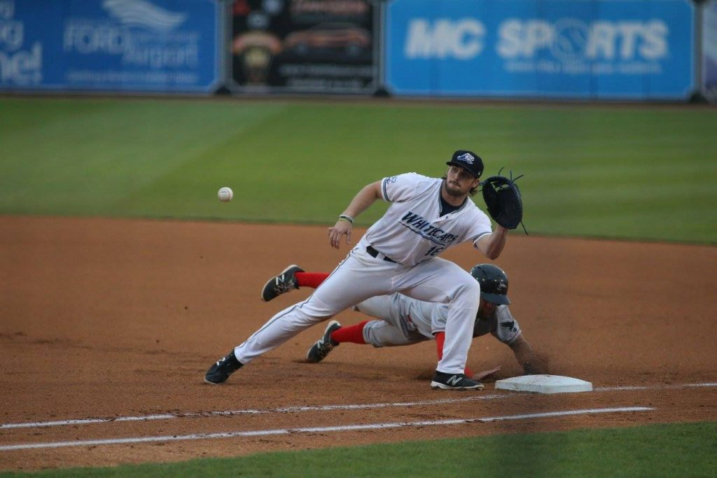 Will Allen tries to make the tag at first base. Photo/Tom Reynolds