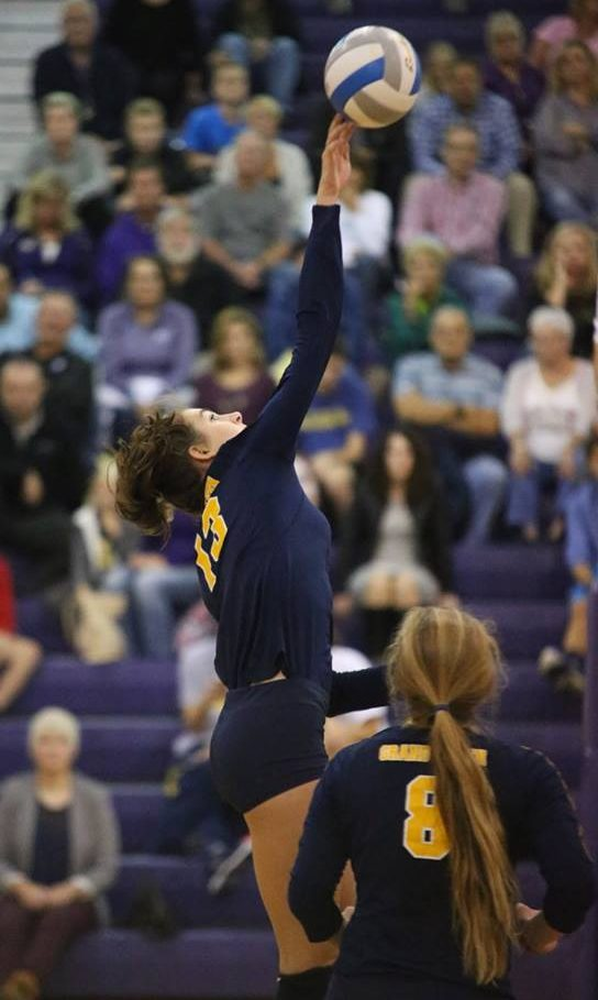 Grand Haven's Avolyn Lepo reaches for the block. Photo/Tom Reynolds