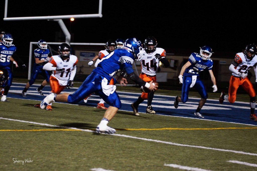 Oakridge QB Brady Luttrull heads into the end zone past the Grant defense. Photo/Sherry Wahr