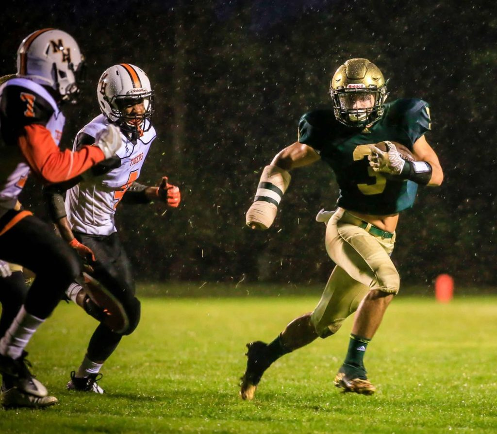 Walker Christoffersen finds the outside edge against Muskegon Heights defense. Photo/Tim Reilly