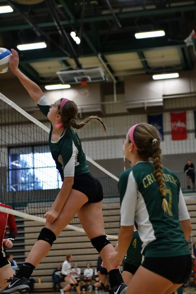 Zoie Price spikes the ball for MCC. Photo/Michael Banka