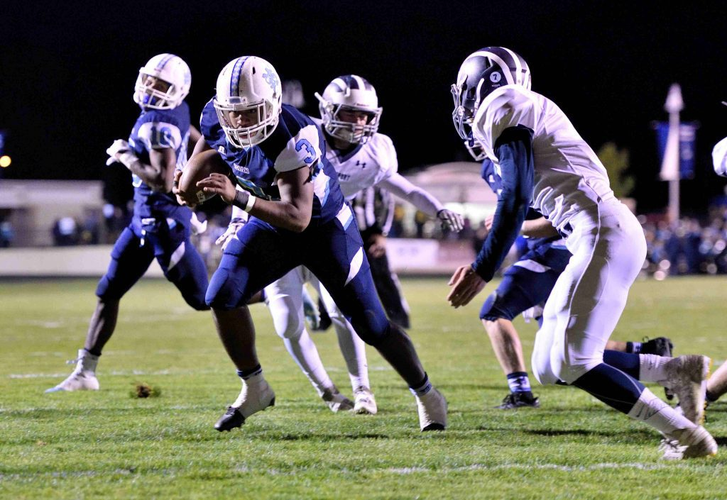 Mona Shores' Marcus Collins (3) punches it in for a touchdown.  (photo/Eric Sturr)