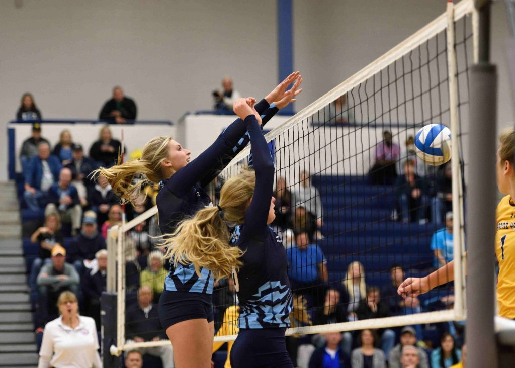 Mona Shores Madison Dunn puts up a successful block. (photo/Eric Sturr)