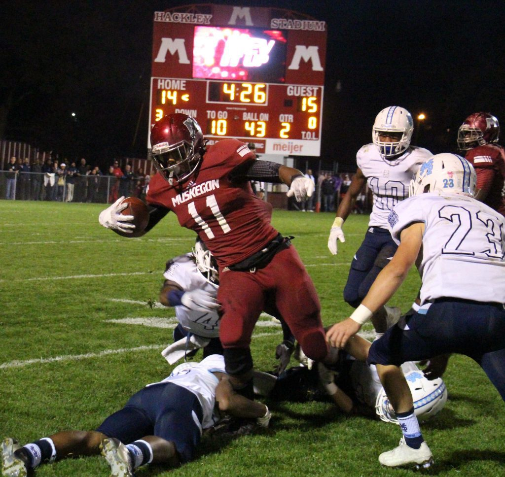 Muskegon's Jacory Sullivan fights against the Mona Shores defense for extra yards. Photo/Jason Goorman