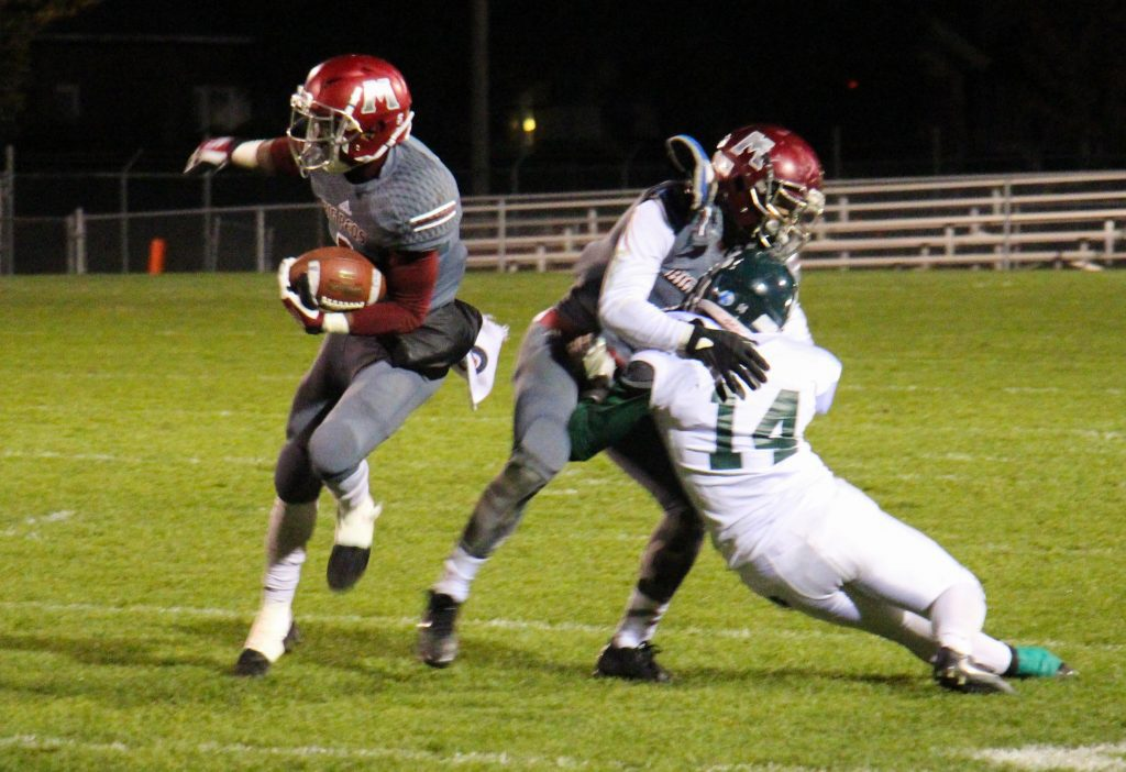Kalil Pimpleton gets the block from Raquis McDonald on the Muskegon rush. Photo/Jason Goorman