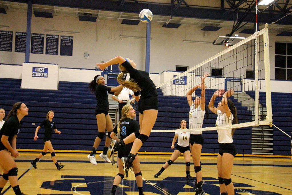 Mona Shores' No. 1 Ryleigh Wehler goes up for the spike. Photo/Jason Goorman