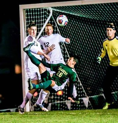 Jose Mojica scores the game-tying goal off a bicycle kick for MCC in the regional finals. Photo/Tim Reilly