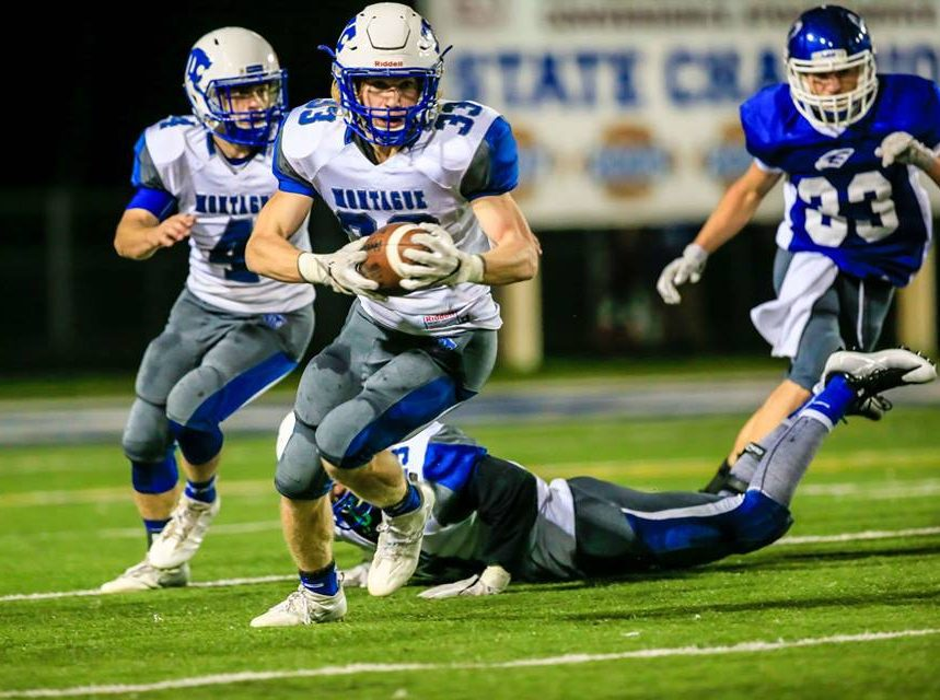 No. 33 Bryce Stark carries the ball upfield for Montague. Photo/Tim Reilly
