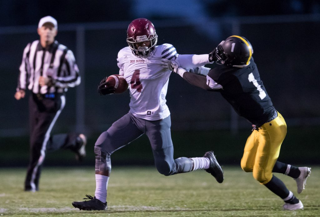 Raquis Mcdonald (4) field a punt return and breaks a tackle as he moves up field. Photo/Kevin Sielaff