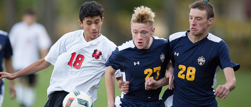 Grand Haven soccer team falls to GR Union 3-2 in district final shootout