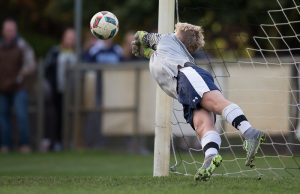 Grand Haven goalie Jake Thayer blocks a Union kick. Photo/Randy Riksen