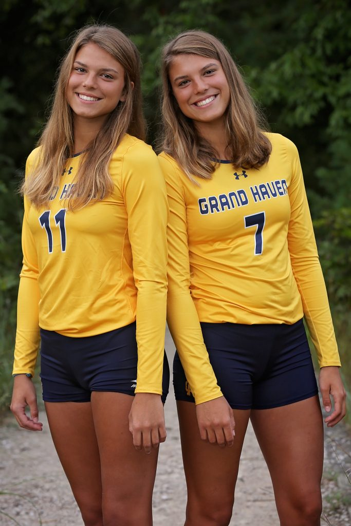 Libby (left) and Katie Cole, twins who help spark the Grand Haven volleyball team.