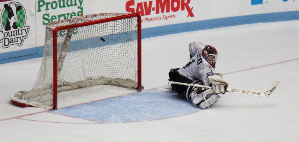 Lumberjacks goalie Adam Brizgala posts the save. Photo/Jason Goorman